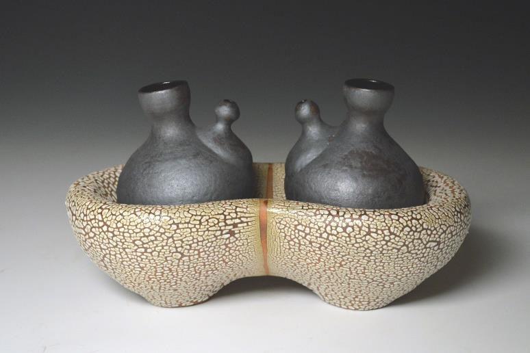 Alisa Holen (American, b. 1959) Quicksand Servers, Porcelain