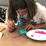 girl creating mixed media art